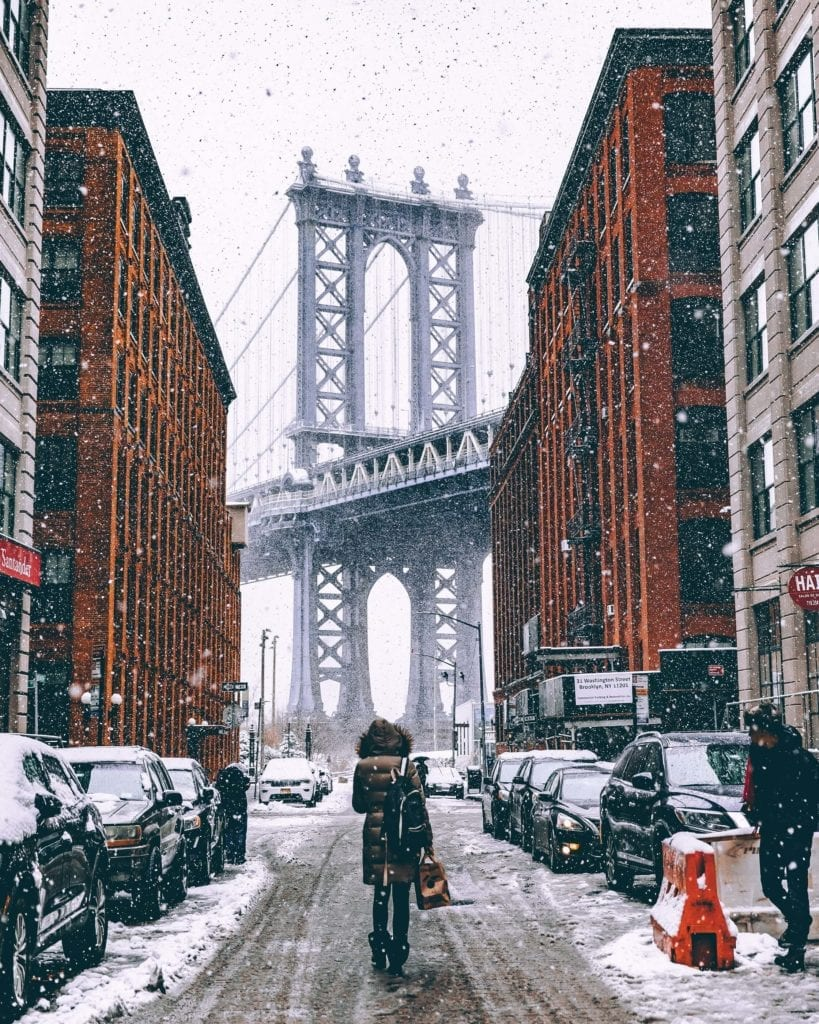 A photo of a lady walking in Brooklyn, New York City
