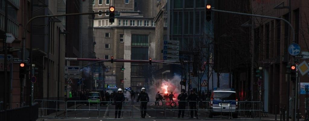 A photo of a policeman creating a barricade